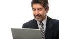 Hombre de negocios hispánico using laptop Fotografía de archivo libre de regalías
