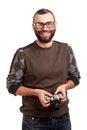 Hombre joven con la barba que sostiene la cámara de la foto Fotografía de archivo