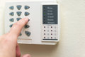 Home alarm system hand is setting security Stock Photo