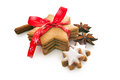 Home baked christmas cookies on white with red ribbon Stock Image
