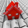 Home based business house standing out neighborhood self employe words on a big red in a of small homes to illustrate a employed Stock Photography