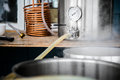 Home Brewing Kit and Pouring Craft Beer Wort into the Boil Kettl Royalty Free Stock Photo