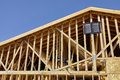 Home building construction carpentry gable end roof framing Royalty Free Stock Photo