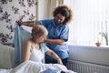 Home caregiver dressing senior Royalty Free Stock Photo