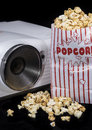 Home cinema projector fresh made popcorn Royalty Free Stock Photography
