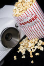 Home cinema projector fresh made popcorn Royalty Free Stock Images