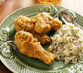 Home cooked fried chicken meal with cilantro lime quinoa side dish Stock Photo