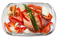 Home cooking tray overview glass with turkey leg rosemary onions tomato and bell pepper ready to cook in oven Stock Photo