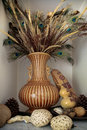 Home decoration an arrangement of of peacock feathers in a vase pine cones and other wooden objects Stock Images