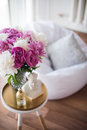 Home decoration, fresh pink peonies on coffee table in white roo Royalty Free Stock Photo
