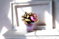 Home decoration, picture frame and flowers on the bedside table Royalty Free Stock Photo
