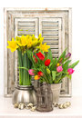 Home decoration with spring flowers easter eggs fresh and tulips and narcissus bouquet Stock Photos