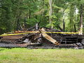 Home destroyed by fire charred remains of a and burned to the ground Stock Images