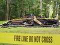Home destroyed by fire line in front of charred remains of a Stock Photography