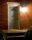 Home entrance at night front door of a house with a welcoming light on Royalty Free Stock Photo