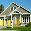 Home exterior with yellow doors new house for sale Stock Images