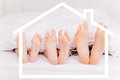 Home feet bed as symbol of new real estate Stock Image