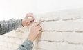 Home improvement close up of a specialist installing decorative brick wall texture with copy space Royalty Free Stock Photos