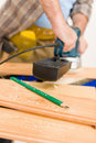Home improvement - handyman sanding wooden floor Royalty Free Stock Photo