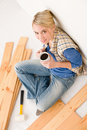 Home improvement - handywoman coffee break Royalty Free Stock Photography