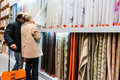 Home improvement store customers choosing textiles in hornbach romania Stock Photo
