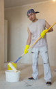 Home improvement young man painting ceiling worker with roller Stock Image