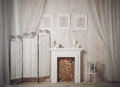 Home interior with white fireplace pictures and candles stock photo Stock Image