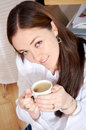 Home lifestyle - girl drinking coffee Stock Photos