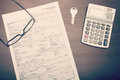 Home loan application form on desk with glasses key and calculator viewed from abobve Royalty Free Stock Photo