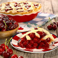 Home made cheery pie fresh with fresh cherries on a picnic table Stock Photos