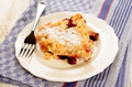 Home made cherry crumble with powdered sugar on a plate Royalty Free Stock Photo