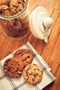 Home made cookies biscuits with cacao chips in glass jar in rustic style Royalty Free Stock Photo