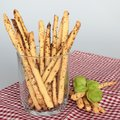 Home made crispy sticks on red napkin with basil leaves Royalty Free Stock Image
