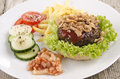 Home made hamburger on a plate Royalty Free Stock Photo