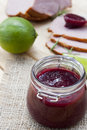 Home made organic cherry jam confiture smoked meat and lime on a wooden table Stock Photo