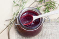Home made organic cherry jam confiture on a wooden table Royalty Free Stock Images