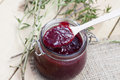Home made organic cherry jam confiture on a wooden table Royalty Free Stock Photography