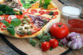 Home made pizza on the table Royalty Free Stock Images
