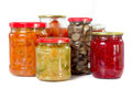 Home made preserves mushrooms tomatoes beet carrot and paprika in jars isolated on white background Royalty Free Stock Photo