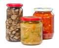 Home made preserves mushrooms tomatoes and paprika in jars isolated on white background Royalty Free Stock Images