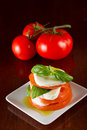 Home made salad slices fresh mozzarella organic tomatoes basil olive oil served white plate vine ripe tomatoes background Stock Photos