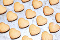 Home made shortbread heart shaped cookies on baking tray Stock Image