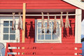Home made stockfish steine traditional fisherman s cabins of the village of in lofoten islands with hanging to dry Royalty Free Stock Photos