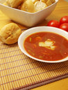 Home made vegetable soup tomato bread rolls Stock Photography