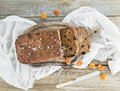 Home-made whole grain bread with dried fruit, seeds and nuts on Royalty Free Stock Photo