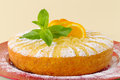 Home made whole testy orange cake with mint decoration Stock Photos