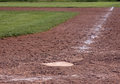 Home plate shallow focus a shot of with just in it on an empty baseball field Stock Image