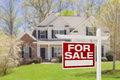 Home For Sale Real Estate Sign and House Royalty Free Stock Photo