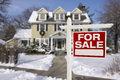 Home for sale sign in front of snowy new house real estate beautiful the snow Stock Photo