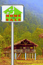 Home for sale signboard concept Stock Photo
